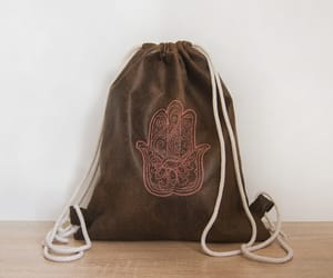 backpack, embroidery, and hamsá image