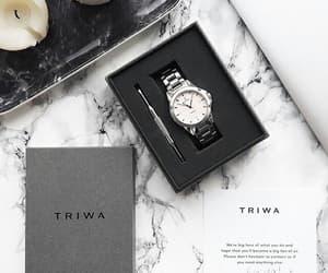 black, classy, and triwa image