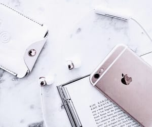 iphone, rose gold, and book image