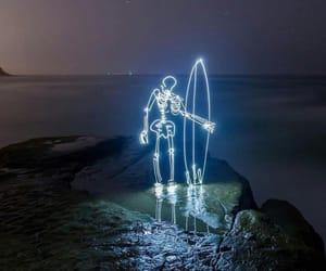 light, night, and surf image