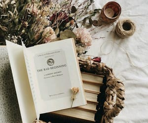 books, candle, and flowers image