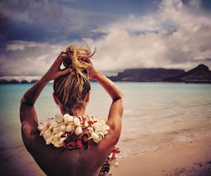 candice swanepoel, beach, and flowers image