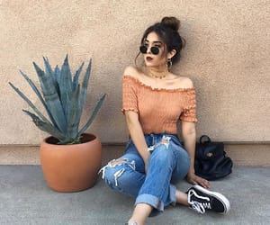 bun, jeans, and orange image