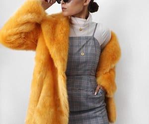 bun, chic, and fur coat image