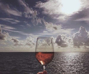 sea, wine, and sky image
