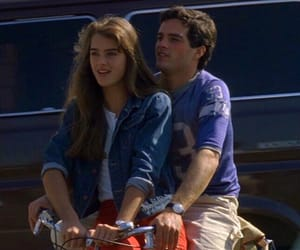 bicycle, brooke shields, and couple image