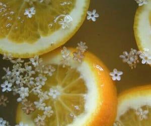 flowers, lemon, and yellow image