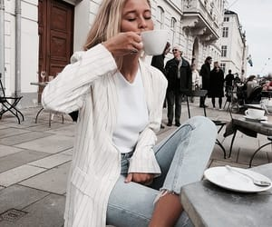 white tshirt, white blazer, and levis jeans image