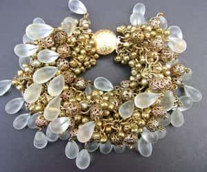 brass, charm bracelet, and glass bracelet image