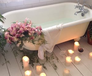 flowers, candle, and bath image