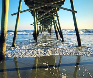 beach, pier, and sun image