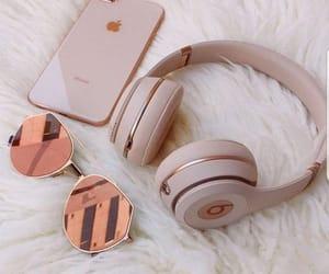 iphone, sunglasses, and headphones image