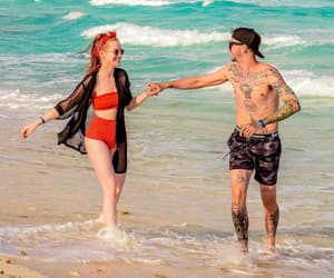 couple, travis mills, and madelaine petsch image