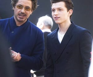 spiderman, robert downey jr, and tom holland image