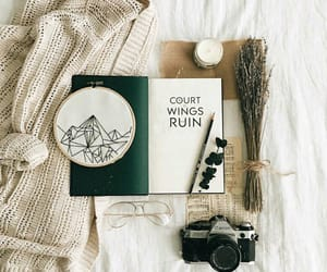 book, camera, and candle image