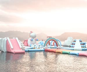 inflatable, unicorn, and rainbow image