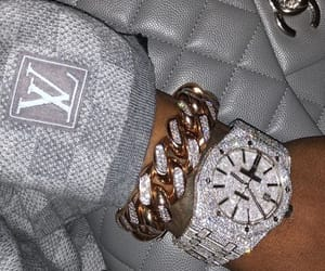 diamond, LV, and watch image