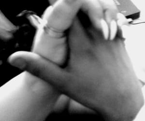 black and white, couple, and holding hands image