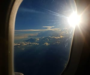 clouds, sun, and travel image