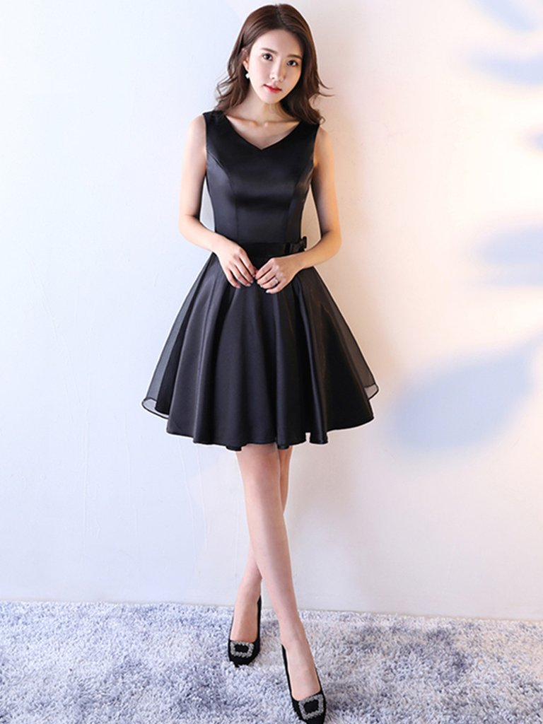 Image result for A short black dress