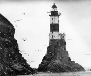 lighthouse, black and white, and sea image