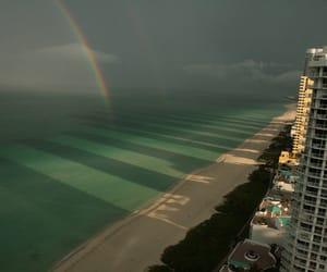 rainbow, beach, and ocean image