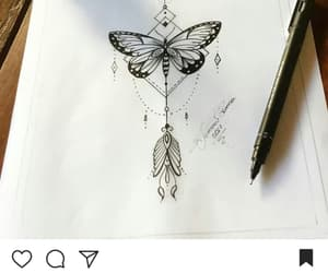arrow, butterfly, and mandala image