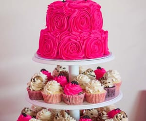 bride and groom, bridesmaids, and wedding cake image