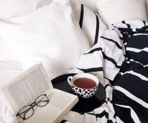 bed, book, and tea image