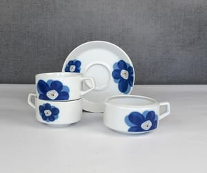 blue flower, creamer, and tea cups image