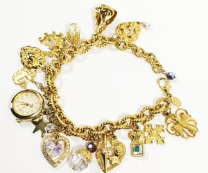 bracelet, charm bracelet, and retired image