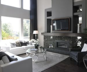 Modern living space with grey fireplace detail