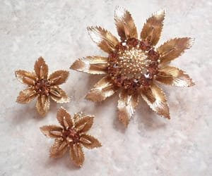 floral earrings, gold tone brooch, and vintage jewelry set image