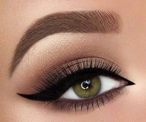 make up, black liner, and green eyes image