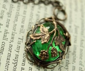 green, necklace, and book image