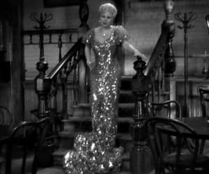 gif, mae west, and she done him wrong image