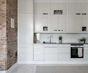 brick wall, dining table, and white kitchen image