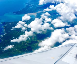birds eye view, blue water, and clouds image