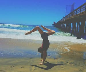 beach, handstand, and pier image