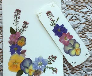 card, journal, and pressed flowers image