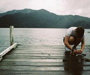 boy, mountains, and lake image