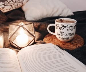 books, candles, and food image