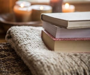 books, candles, and cozy image