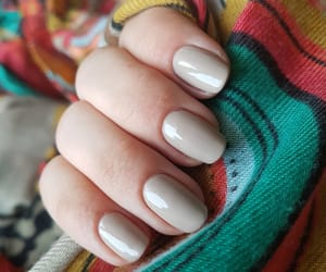 short nails, nude nails, and essie image