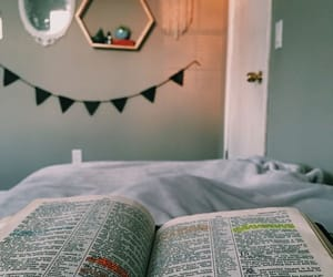 bed, blanket, and book image