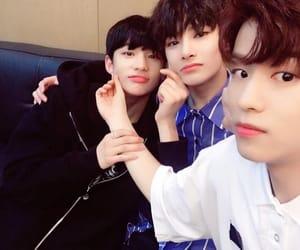 hyunjin, seungmin, and jeongin image