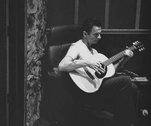 dave gahan, depeche mode, and guitar image
