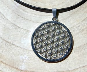 charm necklace, seed of life, and flower of life necklace image