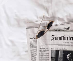newspaper and sunglasses image
