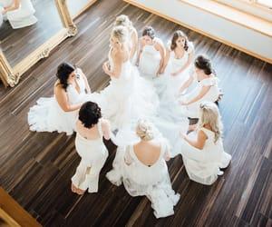 bride, bridesmaids, and wedding dress image